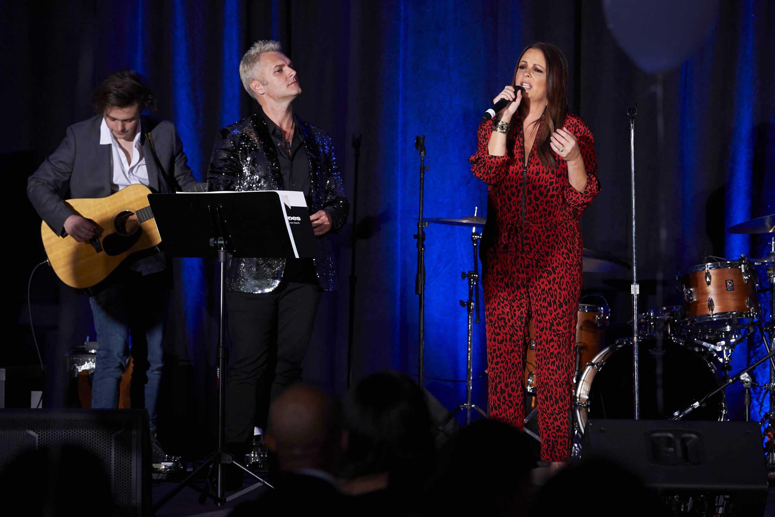 Shane Stevens performs with Sara Evans