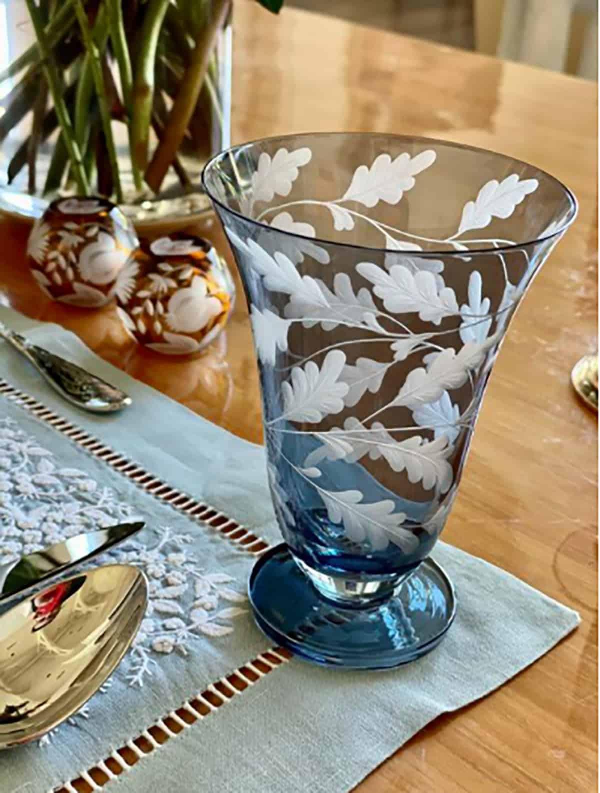 Hand-engraved stemless Oak Leaves goblets by Artel, $190. At ShopKSW.com